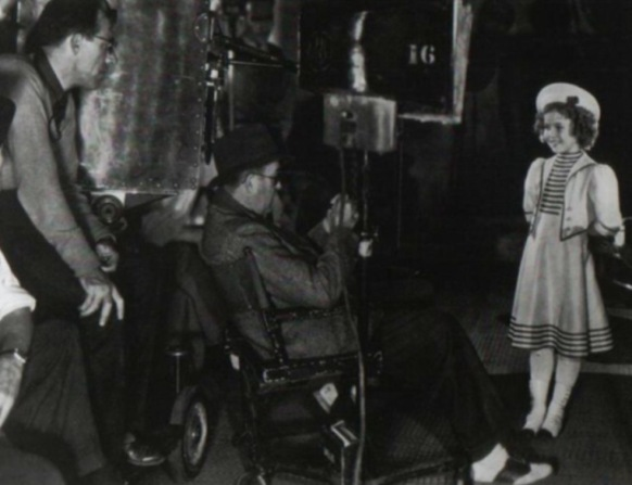 Director John Ford and Shirley Temple from 'The Shirley Temple Archive'
